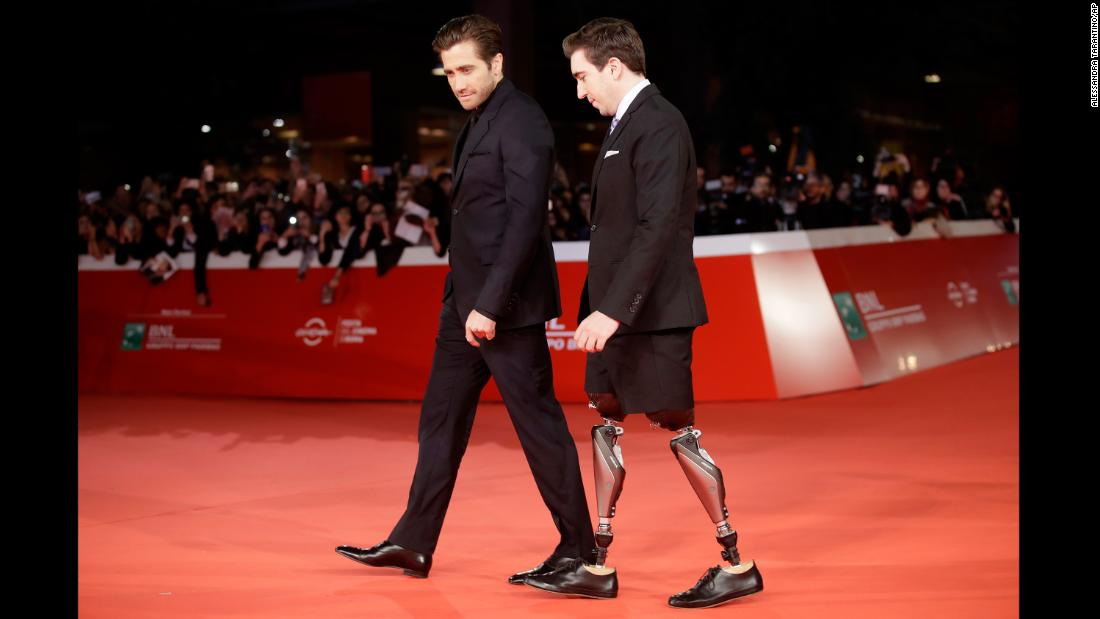 "Actor Jake Gyllenhaal, left, and author Jeff Bauman walk the red carpet at the Rome Film Fest on Saturday, October 28. In the new movie ""Stronger,"" Gyllenhaal plays Bauman, who lost his legs in the Boston Marathon bombing. The film is based on Bauman's memoir."