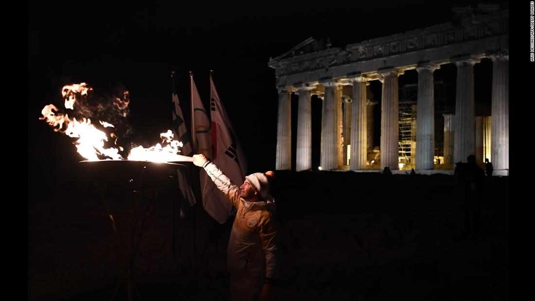 "Greek gymnast Dimosthenis Tampakos lights the Olympic flame in front of the Parthenon in Athens, Greece, on Monday, October 30. The flame <a href=""http://www.cnn.com/2017/11/01/sport/gallery/pyeongchang-2018-winter-olympics-torch/index.html"" target=""_blank"">has arrived</a> in PyeongChang, South Korea, ahead of the 2018 Winter Olympics."