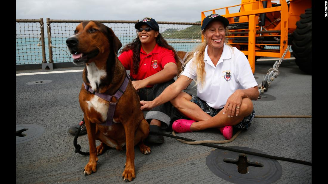 "Jennifer Appel, right, and Tasha Fuiava sit with their dogs on the deck of the USS Ashland on Monday, October 30. The two women from Hawaii were rescued in the Pacific Ocean about 900 miles southeast of Japan. <a href=""http://www.cnn.com/2017/10/31/asia/pacific-sailors-jennifer-appel-tasha-fuiava-questions/index.html"" target=""_blank"">They said they had been stranded on a crippled sailboat</a> for more than five months."