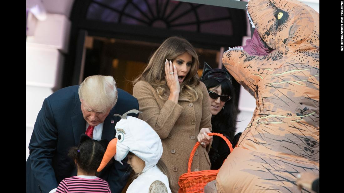 US President Donald Trump and first lady Melania Trump hand out Halloween candy to children at the White House on Monday, October 30.