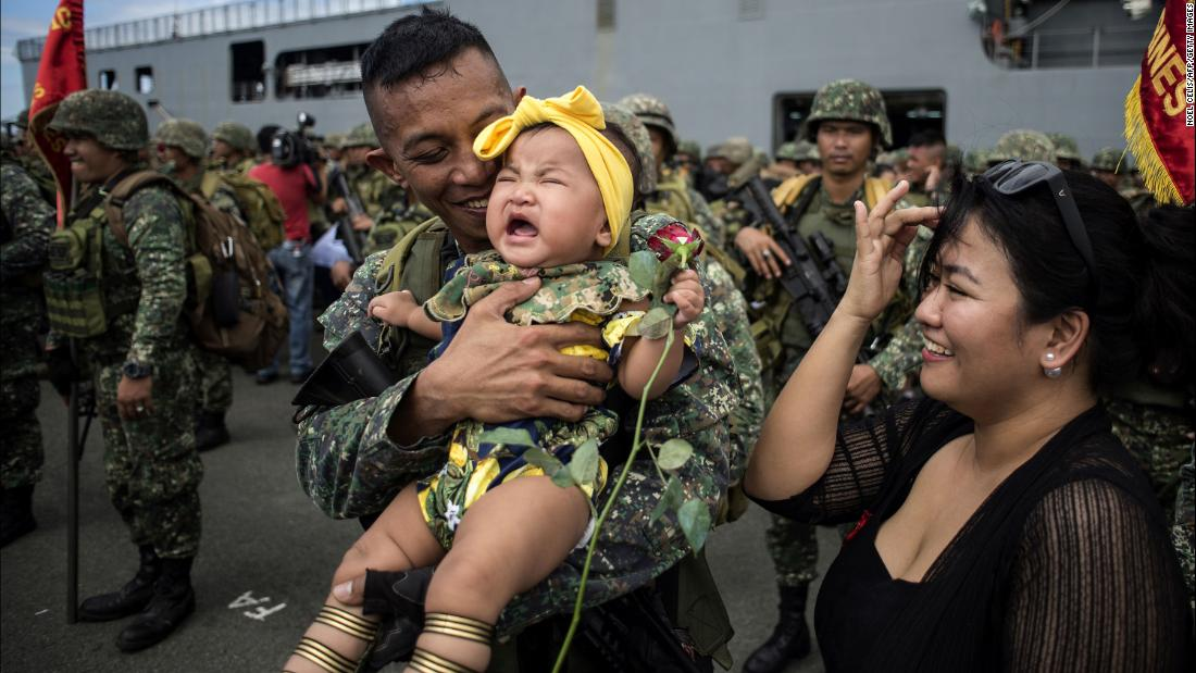 "A Philippine soldier hugs his baby daughter after returning from a five-month deployment in the city of Marawi on Monday, October 30. President Rodrigo Duterte <a href=""http://www.cnn.com/2017/10/17/asia/duterte-marawi-liberation/index.html"" target=""_blank"">announced last month</a> that Marawi had been liberated from ISIS-affiliated militants."