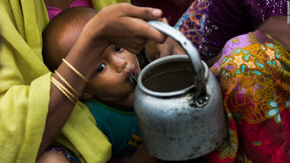 "A crying Rohingya Muslim child drinks water from a kettle as refugees wait for permission to move toward camps near Palong Khali, Bangladesh, on Thursday, November 2. More than 500,000 Rohingya have fled Myanmar since late August, creating ""a humanitarian and human rights nightmare,"" according to Antonio Guterres, secretary-general of the United Nations. <a href=""http://www.cnn.com/interactive/2017/10/world/rohingya-refugees-cnnphotos/"" target=""_blank"">Photos: A new life for the Rohingya</a>"