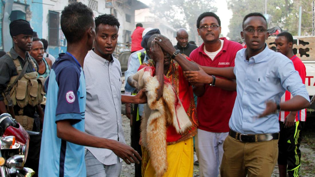 "People help a man who was injured during a car bombing in Mogadishu, Somalia, on Saturday, October 28. <a href=""http://www.cnn.com/2017/10/28/africa/somalia-mogadishu-bombings/index.html"" target=""_blank"">At least 27 people were killed</a> when two car bombs detonated outside a hotel near Somalia's presidential palace, according to Security Minister Mohamed Abukar Islow. The blasts occurred two weeks after the deadliest car bombings in the nation's modern history."