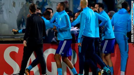 Teammates try to calm down Marseille's defender Patrice Evra.