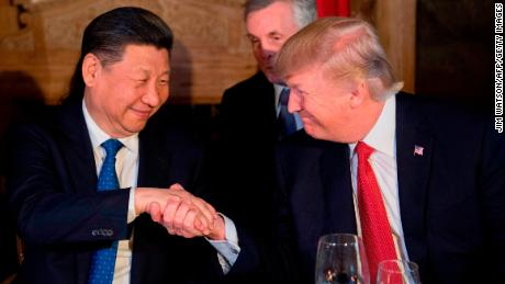 US President Donald Trump and Xi Jinping shake hands during dinner at the Mar-a-Lago estate on April 6.