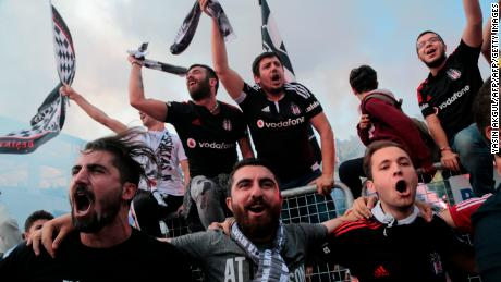 Besiktas' supporters celebrate after their team won the Turkish Super Toto league football match between Besiktas and Osmanlispor at the Vodafone Arena Stadium in Istanbul on May 19, 2016.  Istanbul side Besiktas on May 15 clinched the Turkish Super Lig title with a game to spare, topping the league for the first time since 2009 and claiming Turkey's sole automatic Champions League spot. Besiktas won the match 3-1.  / AFP / YASIN AKGUL        (Photo credit should read YASIN AKGUL/AFP/Getty Images)