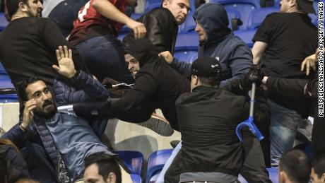 Besiktas and Lyon supporters clash before the Europa League match in April.