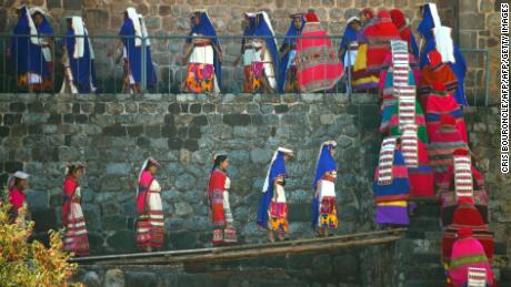 "Performers take part in the recreation of the morning salute to the sun by the Inca emperor (out of frame) at the Coricancha temple in Cuzco, Peru on June 24, 2017, at the start of the Inti Raymi or Sun Festival.  The Inti Raymi, celebrated from time immemorial, is the most important indigenous ceremony of the Peruvian Andes, held in honor of the god Inti (Quechua for ""sun"") at the beginning of the winter solstice. / AFP PHOTO / CRIS BOURONCLE        (Photo credit should read CRIS BOURONCLE/AFP/Getty Images)"