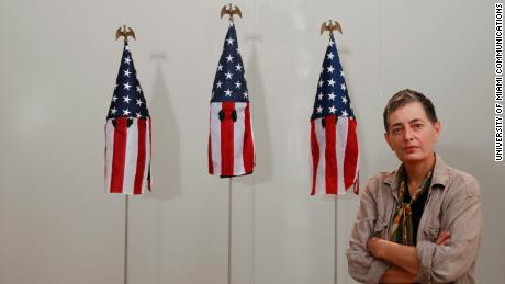 "Artist Billie Lynn, an art professor at the University of Miami, stands with ""American Mask."""