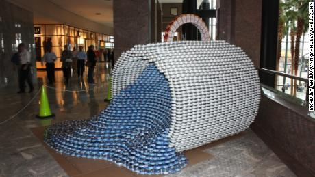 "The ""Cups can only spill"" submission at the CANstruction competition in New York City was created by Gilsanz Murray Steficek, LLP. The structure is made from 5,180 cans. The exhibit is part of the 18th Annual CANstruction contest."