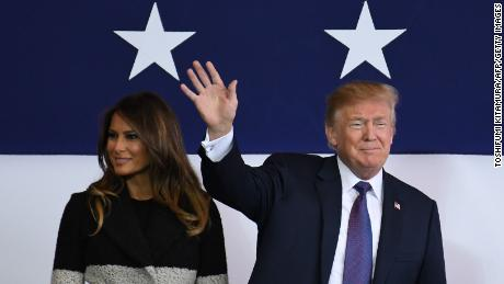 US President Donald Trump (R) waves as First Lady Melania smiles upon arriving at US Yokota Air Base in Tokyo on November 4, 2017. Trump touched down in Japan, kicking off the first leg of a high-stakes Asia tour set to be dominated by soaring tensions with nuclear-armed North Korea. / AFP PHOTO / Toshifumi KITAMURA / The erroneous mention[s] appearing in the metadata of this photo by Toshifumi KITAMURA has been modified in AFP systems in the following manner: [November 5] instead of [November 4]. Please immediately remove the erroneous mention[s] from all your online services and delete it (them) from your servers. If you have been authorized by AFP to distribute it (them) to third parties, please ensure that the same actions are carried out by them. Failure to promptly comply with these instructions will entail liability on your part for any continued or post notification usage. Therefore we thank you very much for all your attention and prompt action. We are sorry for the inconvenience this notification may cause and remain at your disposal for any further information you may require.        (Photo credit should read TOSHIFUMI KITAMURA/AFP/Getty Images)