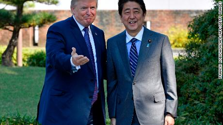 US President Donald Trump (L) gestures with Japanese Prime Minister Shinzo Abe upon his arrival at the Kasumigaseki Country Club in Kawagoe, near Tokyo on November 5, 2017.  Trump touched down in Japan, kicking off the first leg of a high-stakes Asia tour set to be dominated by soaring tensions with nuclear-armed North Korea. / AFP PHOTO / POOL / FRANCK ROBICHON        (Photo credit should read FRANCK ROBICHON/AFP/Getty Images)
