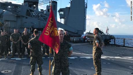 Lt. Jesse Schmitt of Palm Beach, Florida, is promoted to the rank of captain during a ceremony on the Ashland's deck.