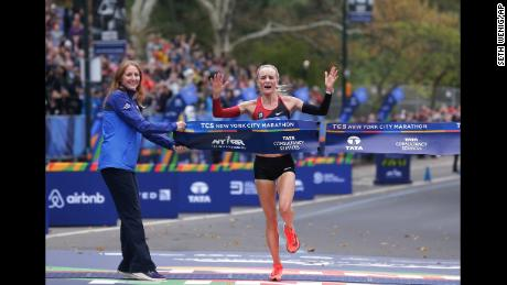 Shalane Flanagan crosses the finish line first in the women's division of the New York City Marathon.