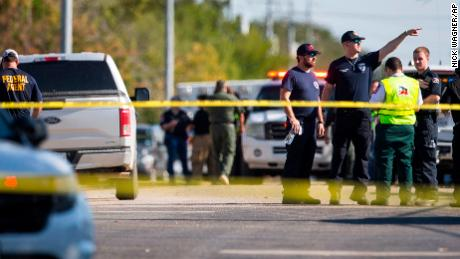 Law enforcement officials work the scene of a fatal shooting at the First Baptist Church in Sutherland Springs, Texas, on Sunday, Nov. 5, 2017. (Nick Wagner/Austin American-Statesman via AP)
