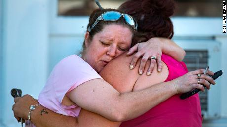 Carrie Matula embraces a woman after a fatal shooting at the First Baptist Church in Sutherland Springs, Texas, on Sunday, Nov. 5, 2017. Matula said she heard the shooting from the gas station where she works a block away. (Nick Wagner/Austin American-Statesman via AP)