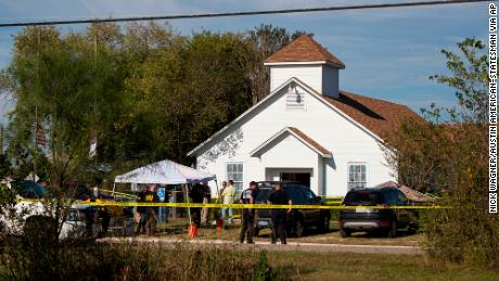 Law enforcement officials works at the scene of a fatal shooting at the First Baptist Church in Sutherland Springs, Texas, on Sunday, Nov. 5, 2017. (Nick Wagner/Austin American-Statesman via AP)