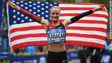 Shalane Flanagan of the US celebrates after she won the Women's  Division during the 2017 TCS New York City Marathon in New York on November 5, 2017.  Five days after the worst attack on New York since September 11, 2001, the city is staging a show of defiance on November 5, as 50,000 runners from around the world are set to participate in the New York Marathon, under heavy security. / AFP PHOTO / TIMOTHY A. CLARYTIMOTHY A. CLARY/AFP/Getty Images