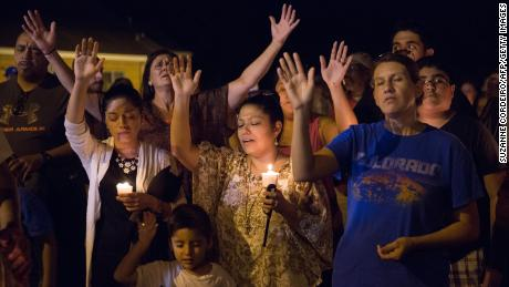 TOPSHOT - A candlelight vigil is observed on November 5, 2017, following the mass shooting at the First Baptist Church in Sutherland Springs, Texas, that left 26 people dead according to authorities. / AFP PHOTO / SUZANNE CORDEIRO        (Photo credit should read SUZANNE CORDEIRO/AFP/Getty Images)
