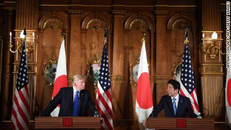 "US President Donald Trump and Japanese Prime Minister Shinzo Abe (R) attend a joint press conference at Akasaka Palace in Tokyo on November 6, 2017. Donald Trump described North Korea's nuclear missile programme as a ""threat"" to the world on a trip to Asia dominated by the crisis. / AFP PHOTO / JIM WATSON        (Photo credit should read JIM WATSON/AFP/Getty Images)"