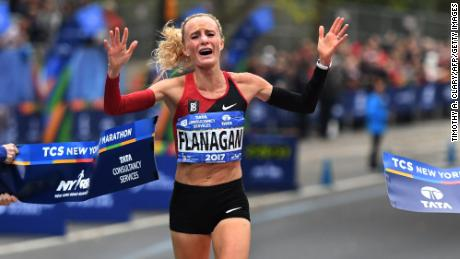 TOPSHOT - Shalane Flanagan of the US celebrates after crossing the finish line to win the Women's  Division during the 2017 TCS New York City Marathon in New York on November 5, 2017. 