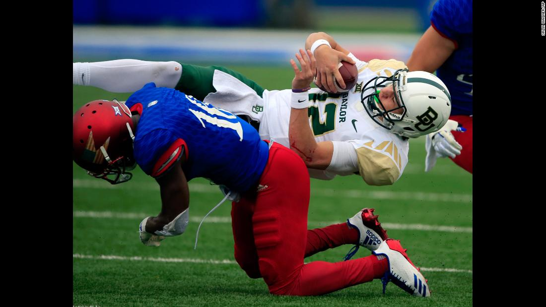 Baylor quarterback Charlie Brewer is tackled by Kansas cornerback Kyle Mayberry during a college football game in Lawrence, Kansas, on Saturday, November 4.