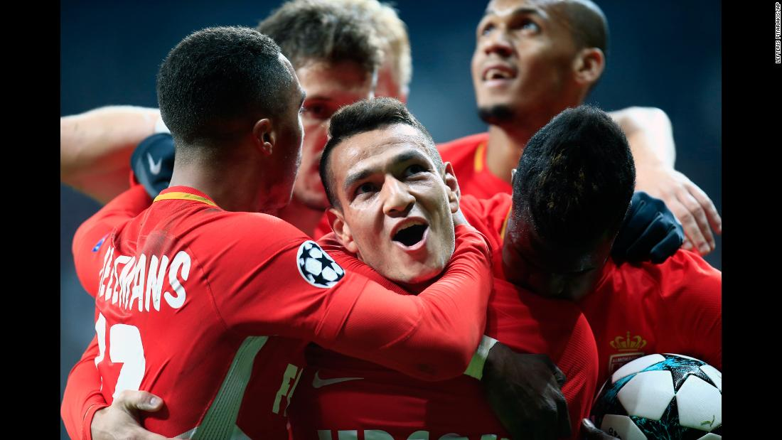 Marcos Lopes, center, is swarmed by his Monaco teammates after scoring the opening goal of their Champions League match against Besiktas on Wednesday, November 1. The match ended 1-1 in Istanbul.