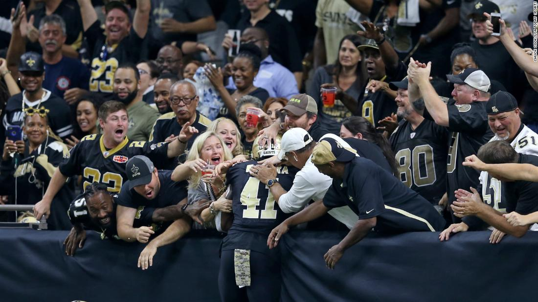 New Orleans running back Alvin Kamara celebrates a touchdown with fans during an NFL game against Tampa Bay on Sunday, November 5. Kamara scored two touchdowns in the Saints' 30-10 victory.