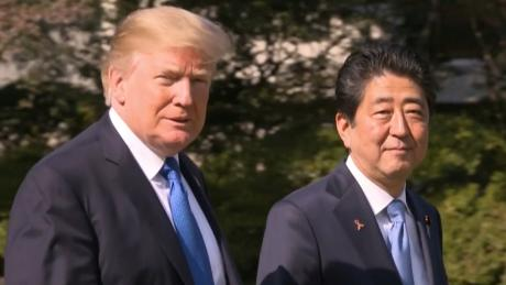 US President Donald J. Trump walks with Japan's Prime Minister Shinzo Abe on November 6, 2017