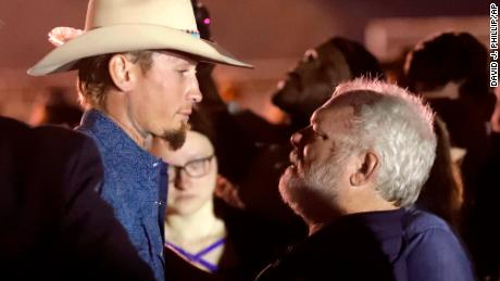 Stephen Willeford, right, hugs Johnnie Langendorff during a vigil for the victims of the First Baptist Church shooting Monday, Nov. 6, 2017, in Sutherland Springs, Texas.