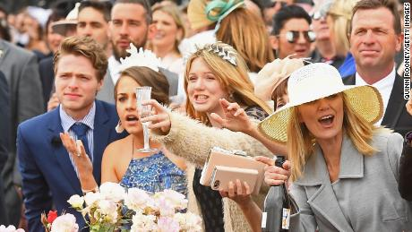 Fans cheer on the horses during Melbourne Cup Day at Flemington Racecourse in 2017.