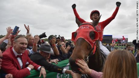 Jockey Kerrin McEvoy celebrates on Redzel after they won the Everest 2017 horse race, the world richest turf race at Royal Randwick race course in Sydney on October 14, 2017. / AFP PHOTO / PETER PARKS / -- IMAGE RESTRICTED TO EDITORIAL USE - STRICTLY NO COMMERCIAL USE --        (Photo credit should read PETER PARKS/AFP/Getty Images)