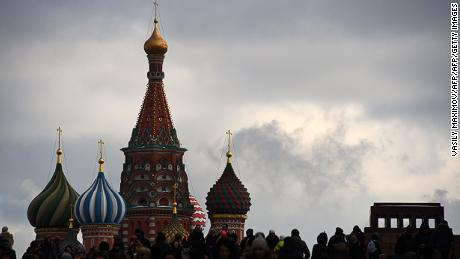 People cross Red Square with St. Basil's Cathedral seen in the background in Moscow on February 11, 2017. / AFP / VASILY MAXIMOV        (Photo credit should read VASILY MAXIMOV/AFP/Getty Images)
