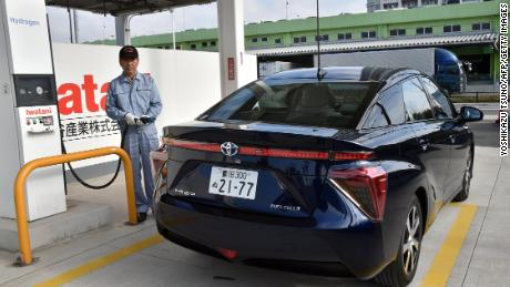 The Toyota Mirai, pictured at a hydrogen station in Tokyo, has a range of 650 kilometers.