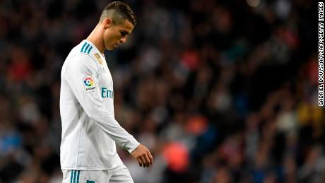 Real Madrid's Portuguese forward Cristiano Ronaldo reacts during the Spanish league football match Real Madrid CF vs UD Las Palmas at the Santiago Bernabeu stadium in Madrid on November 5, 2017. / AFP PHOTO / GABRIEL BOUYS        (Photo credit should read GABRIEL BOUYS/AFP/Getty Images)