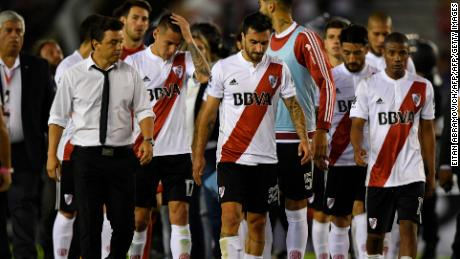 River Plate's footballers leave the field after loosing against Boca Juniors in the Superliga first division tournament derby match at Monumental stadium in Buenos Aires, Argentina, on November 5, 2017. / AFP PHOTO / EITAN ABRAMOVICH        (Photo credit should read EITAN ABRAMOVICH/AFP/Getty Images)