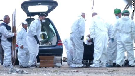 NS Slug: ITALY: BODIES OF MIGRANTS, VICTIMS ARRIVE IN SALERNO  Synopsis: Authorities recovers the bodies of 26 teenage girls  Video Shows: - coffins being loaded up as they arrive on shore     Keywords: ITALY MIGRANTS SALERNO VICTIMS FATALITIES MEDITERRANEAN