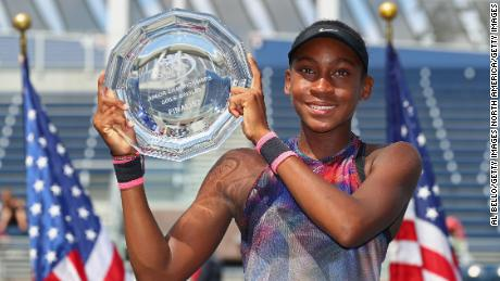 Gauff poses with the US Open's junior girls' runners-up trophy
