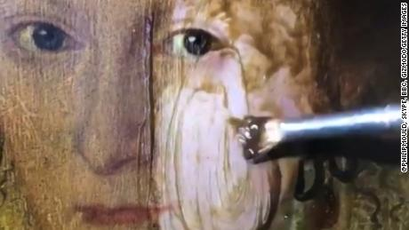 "Watch 200 years of grime on a painting dissolve in seconds. Jeanne Moos reports ""Lady In Red"" is mesmerizing.      Painting grime Gone   The internet is mesmerized watching a 400-year old painting have grime and varnish brushed away in seconds. The host of a British show called ""Fake or Fortune?"" tweeted out a brief video showing ""Lady in Red"" being restored. One poster compared it to using an eraser sponge on bathroom tile. Or jet washing your deck. We'll show the transformation and compare it to one that didn't work...remember botched Jesus turned into what some now call the Monkey painting? So bad it's good. The botched version has become a tourist attraction in its small Spanish village and ended up adorning mugs and other novelties."
