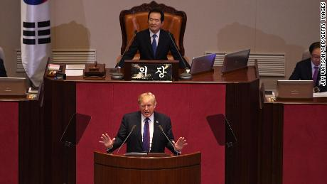 US President Donald Trump (C) addresses the National Assembly in Seoul on November 8, 2017. Trump's marathon Asia tour moves to South Korea, another key ally in the struggle with nuclear-armed North Korea, but one with deep reservations about the US president's strategy for dealing with the crisis. / AFP PHOTO / JIM WATSON        (Photo credit should read JIM WATSON/AFP/Getty Images)