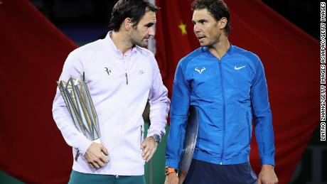 SHANGHAI, CHINA - OCTOBER 15:  Roger Federer of Switzerland with Rafael Nadal of Spain pose with their trophy after the Men's singles final mach on day eight of 2017 ATP Shanghai Rolex Masters at Qizhong Stadium on October 15, 2017 in Shanghai, China.  (Photo by Lintao Zhang/Getty Images)