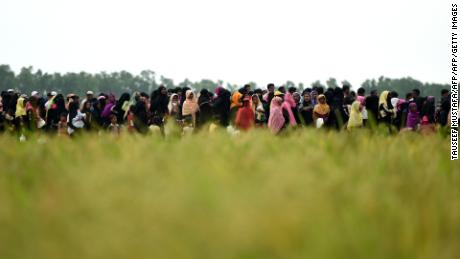 "Rohingya Muslim refugees wait for relief aid at Nayapara refugee camp in Teknaf on October 21, 2017. Thousands of Rohingya Muslims stranded near Bangladesh's border this week after fleeing violence in Myanmar have finally been permitted to enter refugee camps after ""strict screening"", officials said on Ocotber 19. / AFP PHOTO / Tauseef MUSTAFA        (Photo credit should read TAUSEEF MUSTAFA/AFP/Getty Images)"
