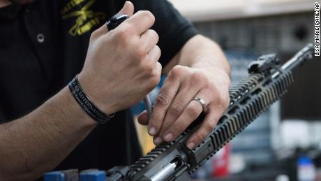 Karl Sorken, production manager for Battle Rifle Co. of Webster, Texas, works on the rails of an AR-15 style rifle.