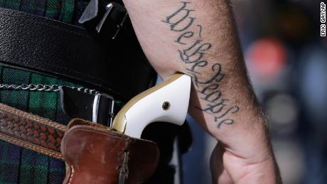A supporter of open carry gun laws wears a pistol at a rally at the state Capitol in Austin.