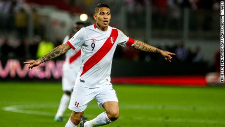 Peru's Paolo Guerrero celebrates after scoring against Colombia during their 2018 World Cup qualifier football match in Lima