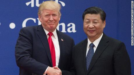 "US President Donald Trump (L) and China's President Xi Jinping shake hands during a business leaders event at the Great Hall of the People in Beijing on November 9, 2017.  Donald Trump urged Chinese leader Xi Jinping to work ""hard"" and act fast to help resolve the North Korean nuclear crisis, during their meeting in Beijing on November 9, warning that ""time is quickly running out"". / AFP PHOTO / Nicolas ASFOURI        (Photo credit should read NICOLAS ASFOURI/AFP/Getty Images)"