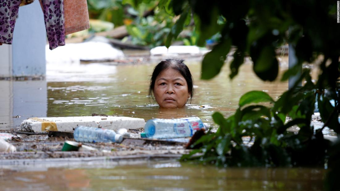 "A woman wades through a flooded street in Hoi An, Vietnam, on Monday, November 6. <a href=""http://www.cnn.com/2017/11/06/asia/vietnam-floods-damrey/index.html"" target=""_blank"">More than 80 people were killed in flooding</a> caused by Tropical Cyclone Damrey, authorities said."