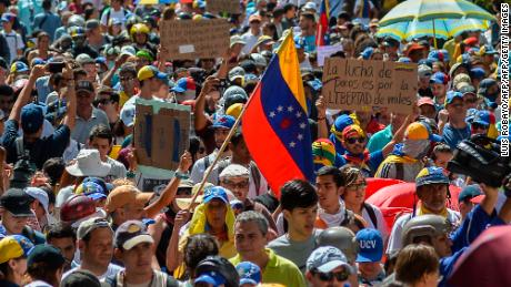 Venezuelan students and other opposition demonstrators protest outside the National Telecommunications Commission (CONATEL) to demand an end to media censorship in the country, in Caracas on June 9, 2017.  Clashes at daily protests by demonstrators calling for Maduro to quit have left 66 people dead since April 1, prosecutors say. / AFP PHOTO / LUIS ROBAYO        (Photo credit should read LUIS ROBAYO/AFP/Getty Images)