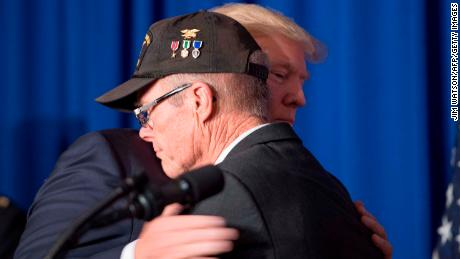 US President Donald Trump hugs Vietnam veteran Max Morgan as he participates in a veterans meet and greet on the sidelines of the Asia-Pacific Economic Cooperation (APEC) leaders' summit in the central Vietnamese city of Danang on November 10, 2017.