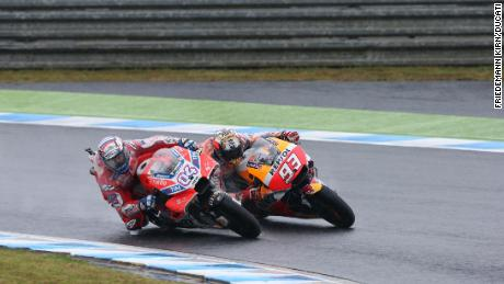 Dovizioso and Marquez go wheel to wheel in Motegi, Japan.